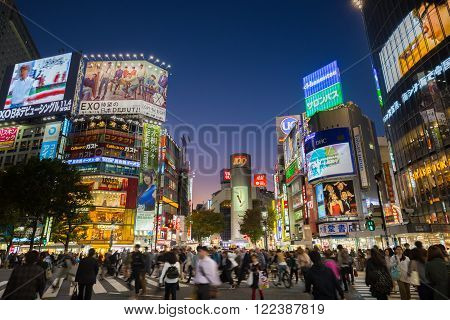 Tokyo, Japan - Nov 6: Pedestrians cross at Shibuya Crossing on November 6th in Tokyo, Japan, 2015 . Shibuya Crossing is one of the busiest crosswalks in the world.