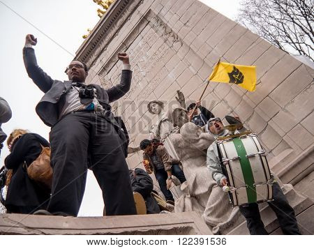 New York, NY, U.S.A. - March 20, 2016 - Documentary Editorial Image - Anti-Trump protestors on a statue in Columbus Circle, New York city, in front of Trump International Hotel and Tower
