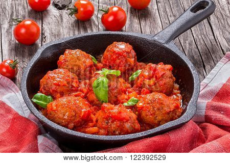 homemade meatballs smothered in a marinara tomato sauce close-up