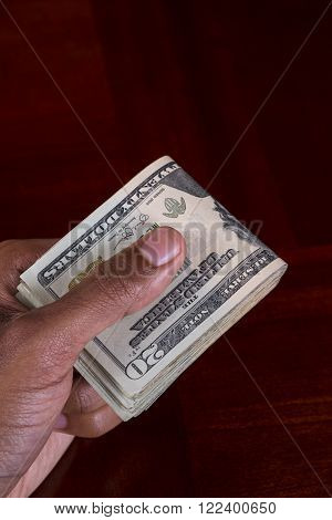 Hand full of money holding 20 Dollar Bill