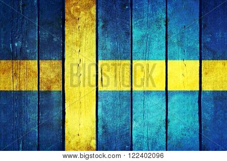 Sweden wooden grunge flag. Sweden flag painted on the old wooden planks. Vintage retro picture from my collection of flags.