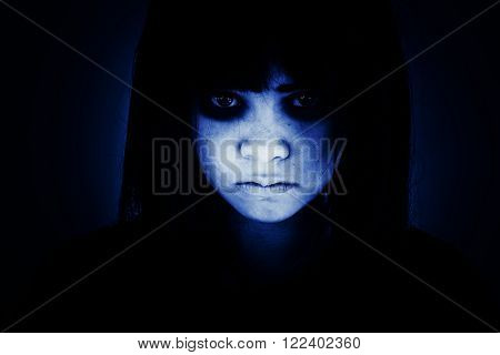 Portrait of scary girl staring at cameras,Ghost girl hiding from the dark,Horror background for halloween