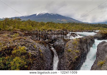 Petrohue Falls and Osorno Volcano with its snow peak in Puerto Varas in nasty weather Puerto Montt - Chile.