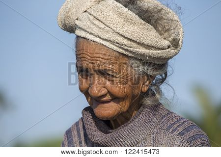 UBUD, BALI, INDONESIA - MARCH 19, 2015 : Unidentified old poor woman to Bali island. Inhabitants of Bali are kind and friendly even in old age