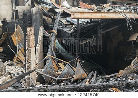 Conflagration fire damaged in summer house after blaze poster