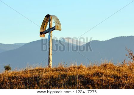 Wooden Cross On Autumn Slope.