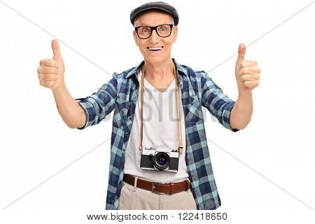 Joyful senior tourist giving two thumbs up isolated on white background
