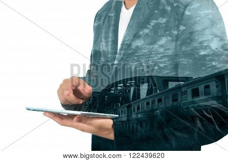 Double Exposure Of Business Man Use Tablet And Train Over Railway Bridge