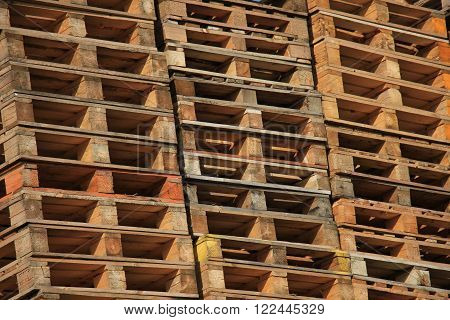 Old, Stacked wooden pallets at a storage