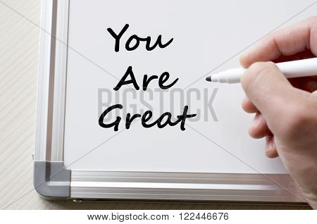 Human hand writing you are great on whiteboard