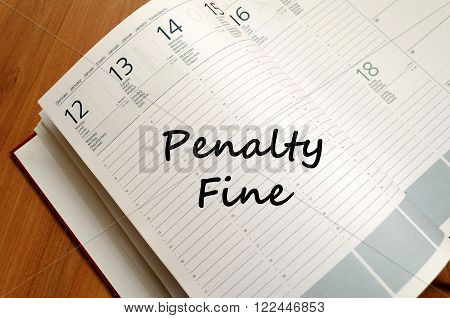 Penalty fine text concept write on notebook