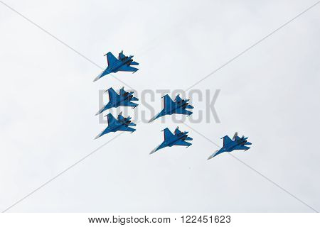 Aerobatics Performed By Aviation Group Of Aerobatics Military-air Forces Russian Knights On Planes S