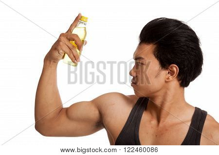 Muscular Asian man flexing biceps with electrolyte drink  isolated on white background