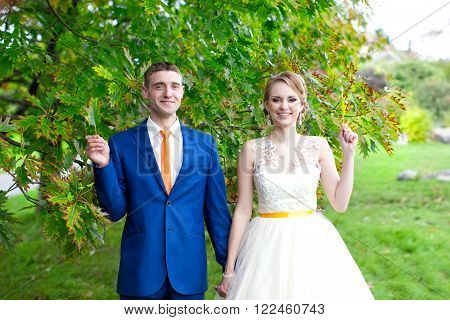 The Happy Newlyweds On A Walk