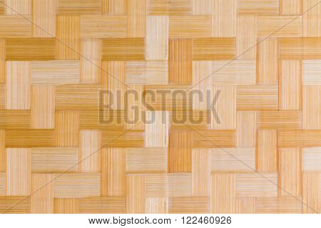 Decorative wooden bamboo texture and pattern of inlaid rectangular blocks on a cutting board in a close up full frame view