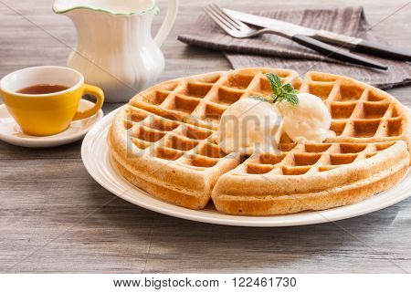 Warm Waffle Breakfast made in a home kitchen with ice cream and maple syryp