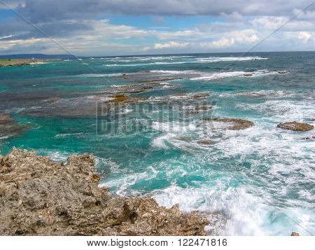 Rocks and strong waves crashing on rocks in the wild north coast of Guadeloupe, Caribbean, French West Indies.