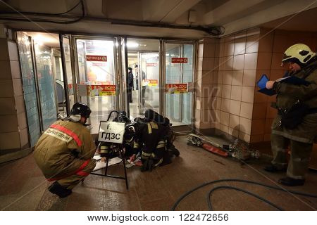 RUSSIA, MOSCOW - 26 FEB, 2015: Firefighters are looking plan of training at Preobrazhenskaya ploshchad subway.