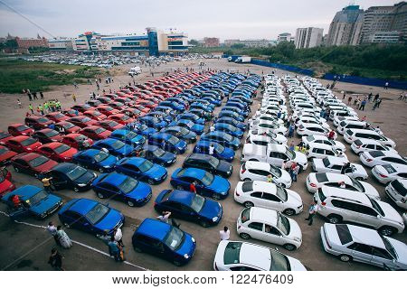 Omsk, Russia - August 22, 2014: Russian Tricolor Car Flashmob. Red, Blue and white automobiles
