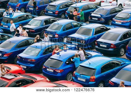 Omsk, Russia - August 22, 2014:  Auto flashmob. Close up view of red and blue cars