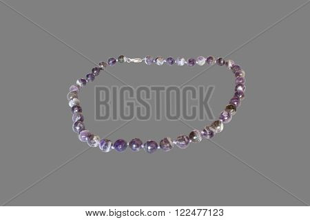 necklace of amethyst.  Isolate on gray background