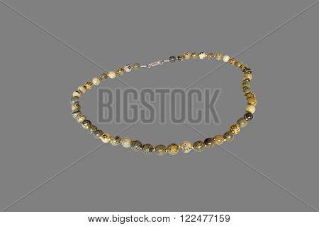 necklace of jasper.  Isolate on gray background