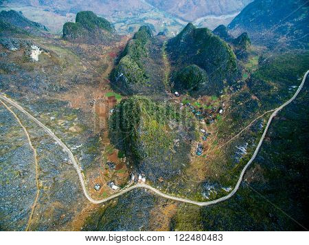 Amazing Ma Pi Leng mountain pass in Dong Van karst plateau global geological park, Hagiang, Vietnam from drone poster