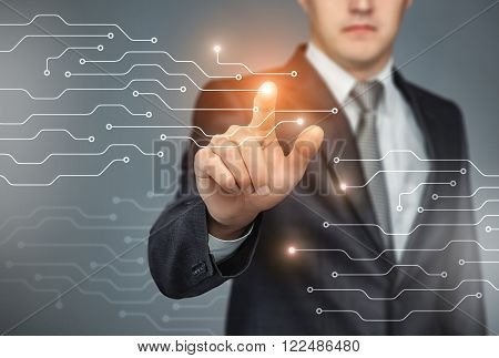 Business man touch digital icons and charts on a the holographic interface. Virtual technology concept