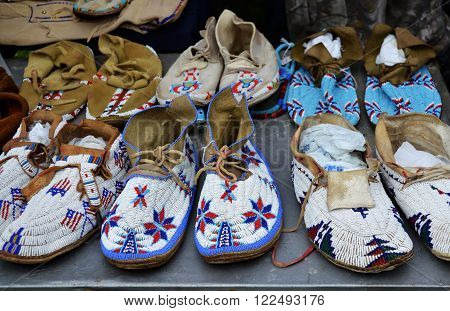 Powow, Moccasins embroidered with multicolored beads Natchez Indian tribe