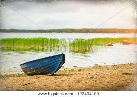 Blue Boat On Sandy Shore. Hamina Camping, Finland, Suomi