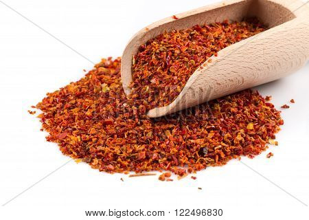 Crushed red chili pepper in spoon on white background poster