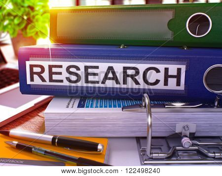 Blue Ring Binder with Inscription Research on Background of Working Table with Office Supplies and Laptop. Research - Toned Illustration. Research Business Concept on Blurred Background. 3D Render.