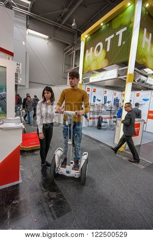 HANNOVER, GERMANY - MARCH 14, 2016: Attendee tests Segway displayed at CeBIT information technology trade show in Hannover, Germany on March 14, 2016.