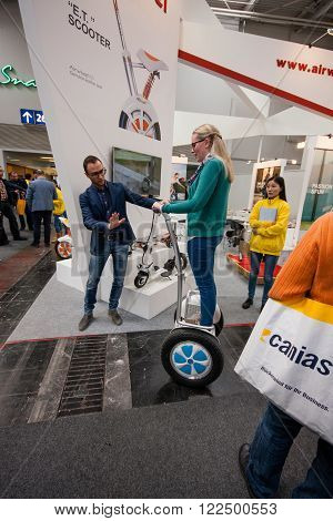 HANNOVER GERMANY - MARCH 14 2016: Attendee tests Segway displayed at CeBIT information technology trade show in Hannover Germany on March 14 2016.