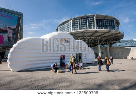 HANNOVER GERMANY - MARCH 14 2016: Cloud booth of Amazon Web Services company at CeBIT information technology trade show in Hannover Germany on March 14 2016.