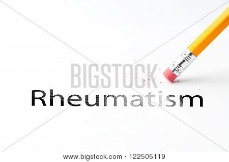Closeup of pencil eraser and black rheumatism text. Rheumatism. Pencil with eraser.
