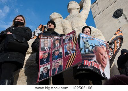 Saint-Petersburg Russia - March 18 2016: the rally on the occasion of the second anniversary of the reunion of Crimea to Russia Participants of the rally with banners and posters President Putin.