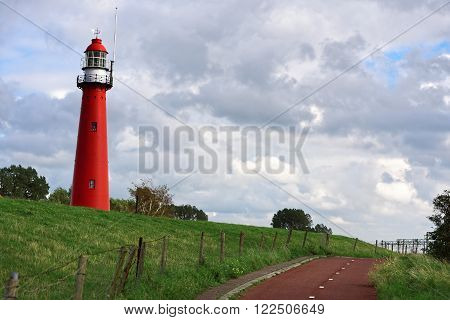 Photo of a Red lighthouse standing on the hill