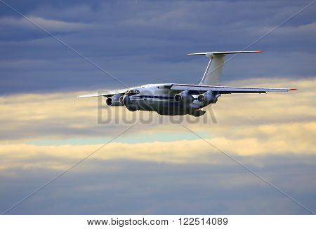 MOSCOW REGION  AUGUST 15: Heavy military cargo aircraft Il 76 flight in the morning sky  on August 15, 2015  in Moscow region
