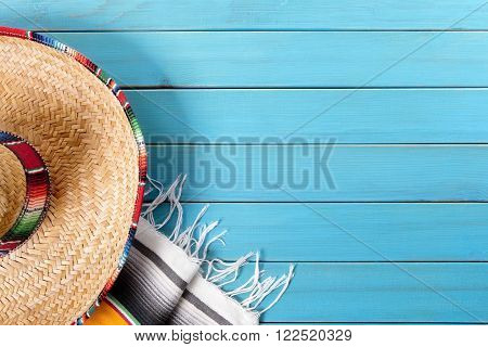 Mexican sombrero and traditional serape blanket background, mexico cinco de mayo fiesta concept