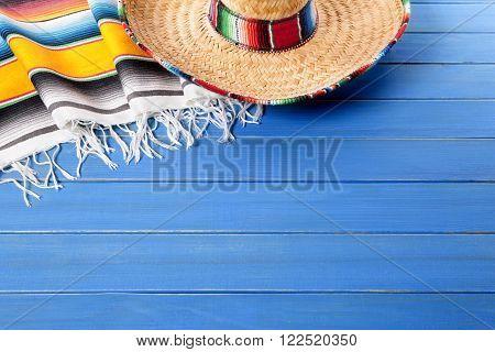 Mexico, Mexican sombrero and traditional serape blanket cinco de mayo fiesta background