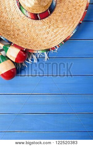 Mexican sombrero and maracas cinco de mayo background border