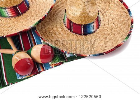Traditional Mexican serape blanket or rug with sombreros and maracas isolated against a white background. Space for copy. poster