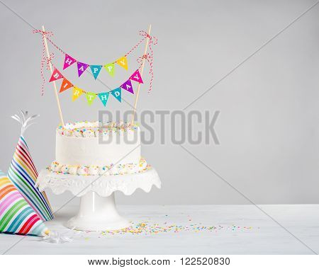 White Birthday Cake Colorful Bunting