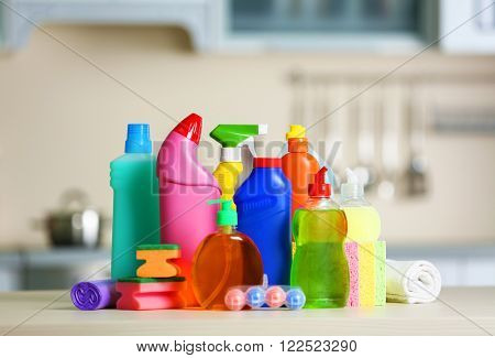 Cleaning set with products and tools on kitchen table