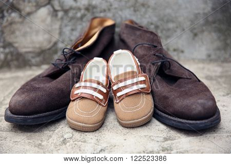 Father and son shoes on concrete stairs