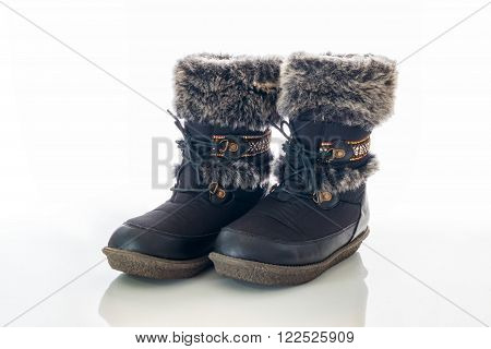 Winter female boot with fur isolated over white