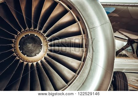 Aircraft engine close-up. Color tone tuned photo