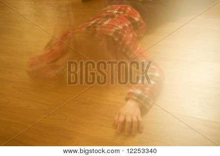 boy laying on the floor