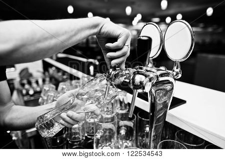 Close Up Of Barman Hand At Beer Tap
